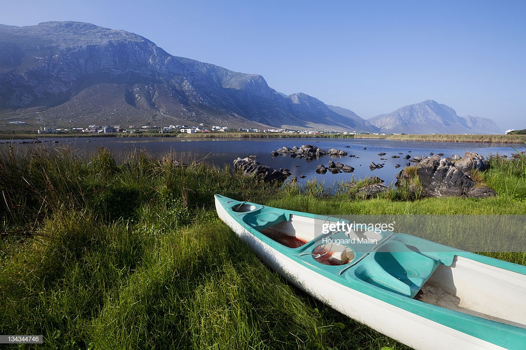 Canoe At Lake With Mountain In Background Bettys Bay South Africa 1024x683
