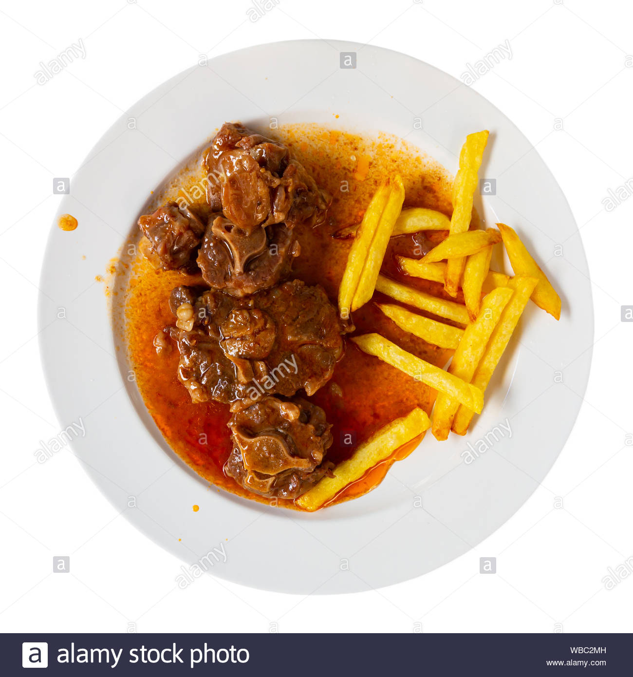Oxtail in sauce   Rabo de toro Spanish dish Isolated over white 1300x1390
