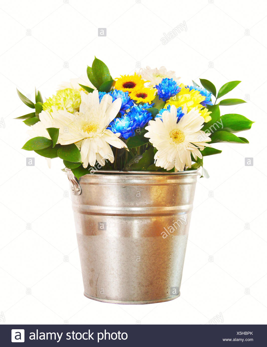 Bouquet of bright flowers in a bucket isolated over white 1071x1390