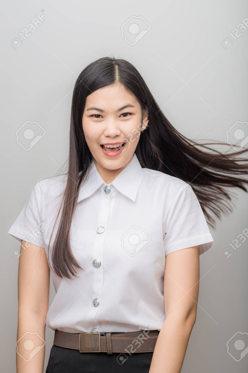 Portrait Of A Glad Young Asian Cute Student On White Background 866x1300