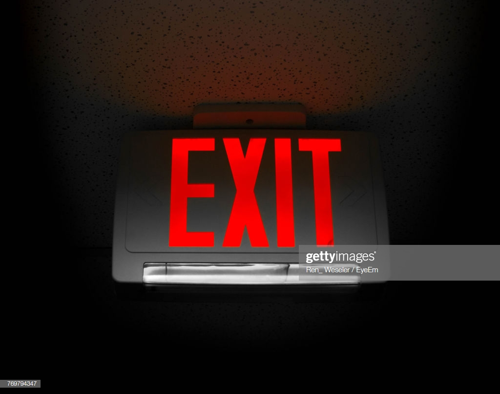 Closeup Of Exit Sign On Black Background High Res Stock Photo 1024x806