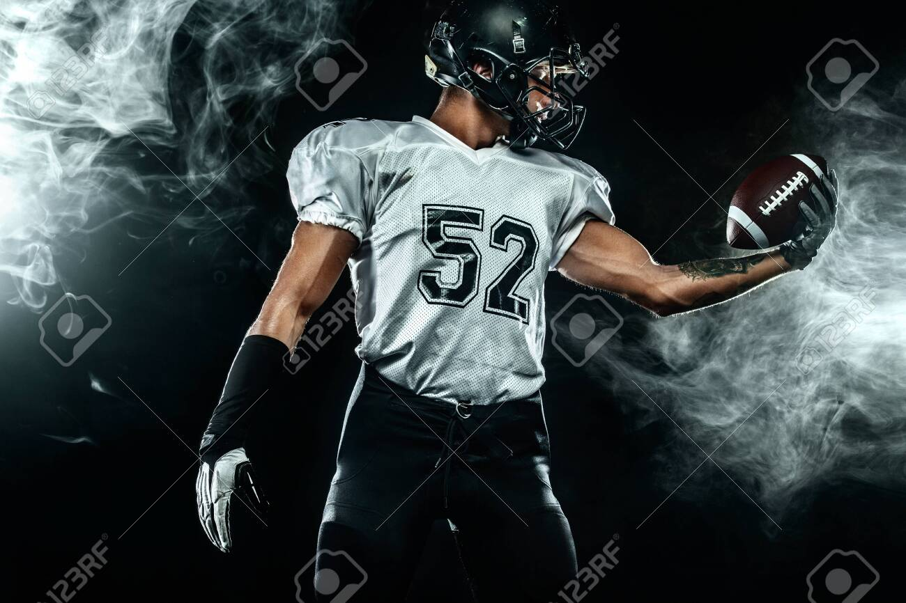 American Football Sportsman Player In Helmet On Black Background 1300x866