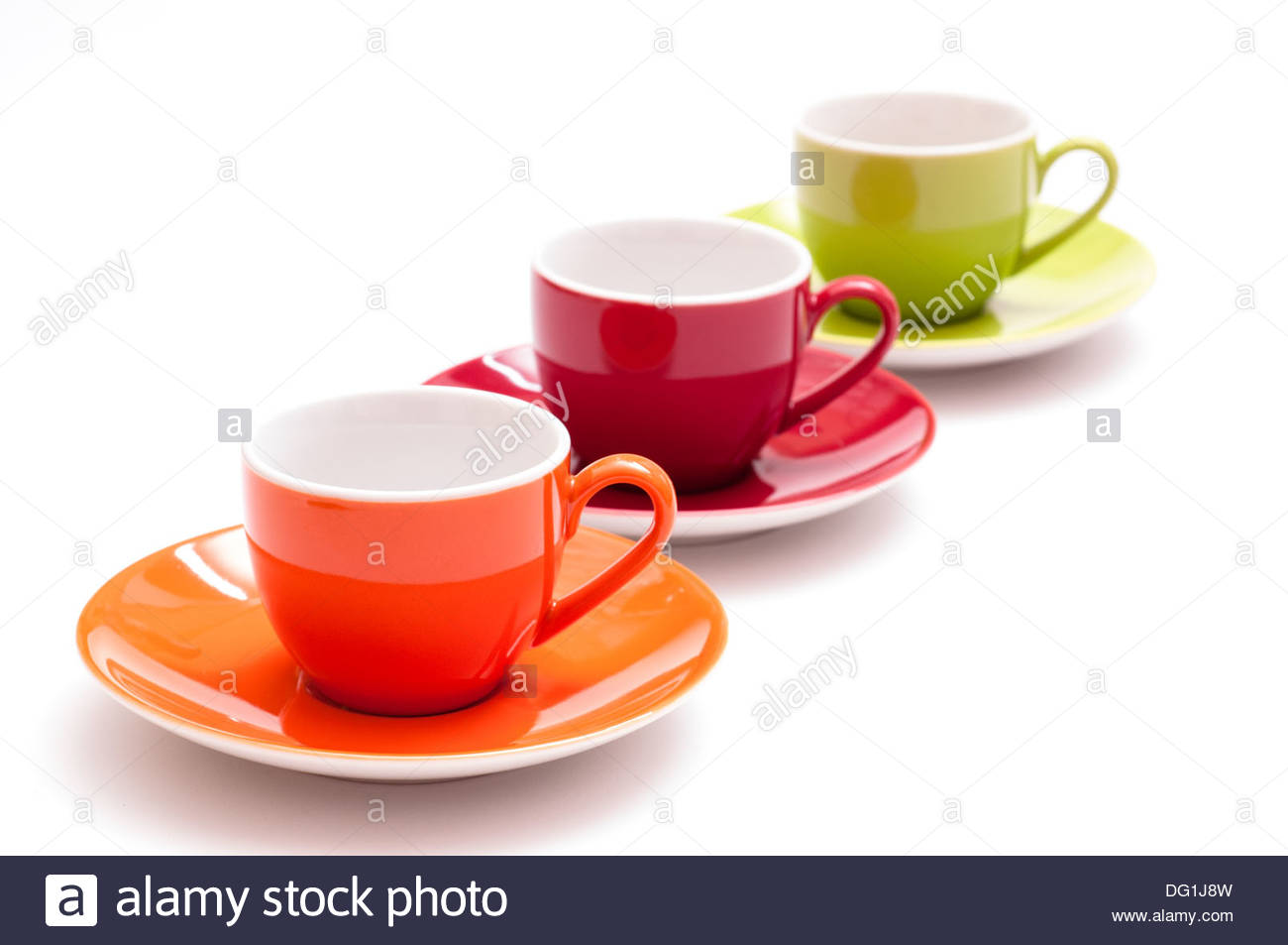 Three coloured expresso cups in a row with white background Stock 1300x953