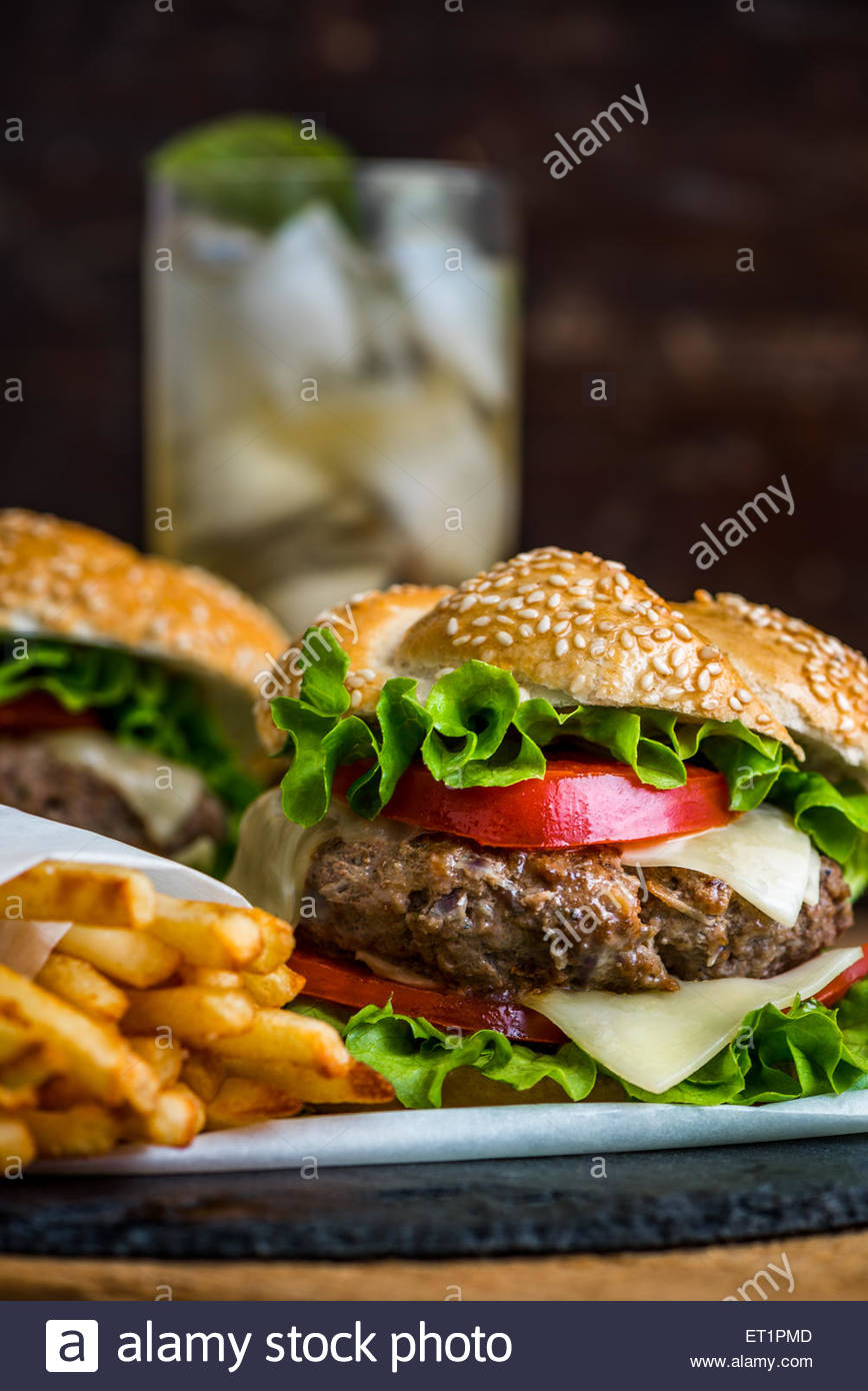 Closeup of Homemade Hamburger with Fresh Vegetables and Drink with 868x1390