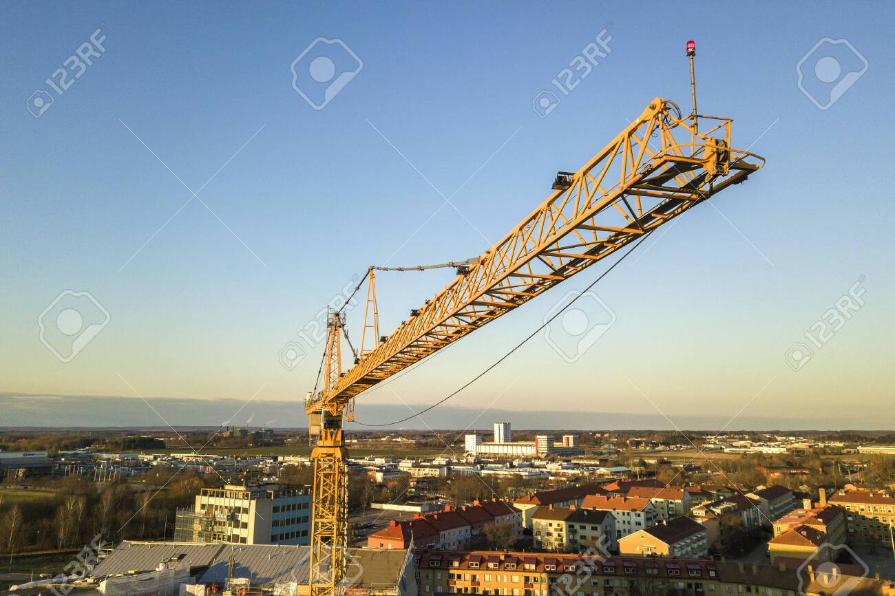 Tower Crane On Bright Blue Sky Copy Space Background City 1300x866