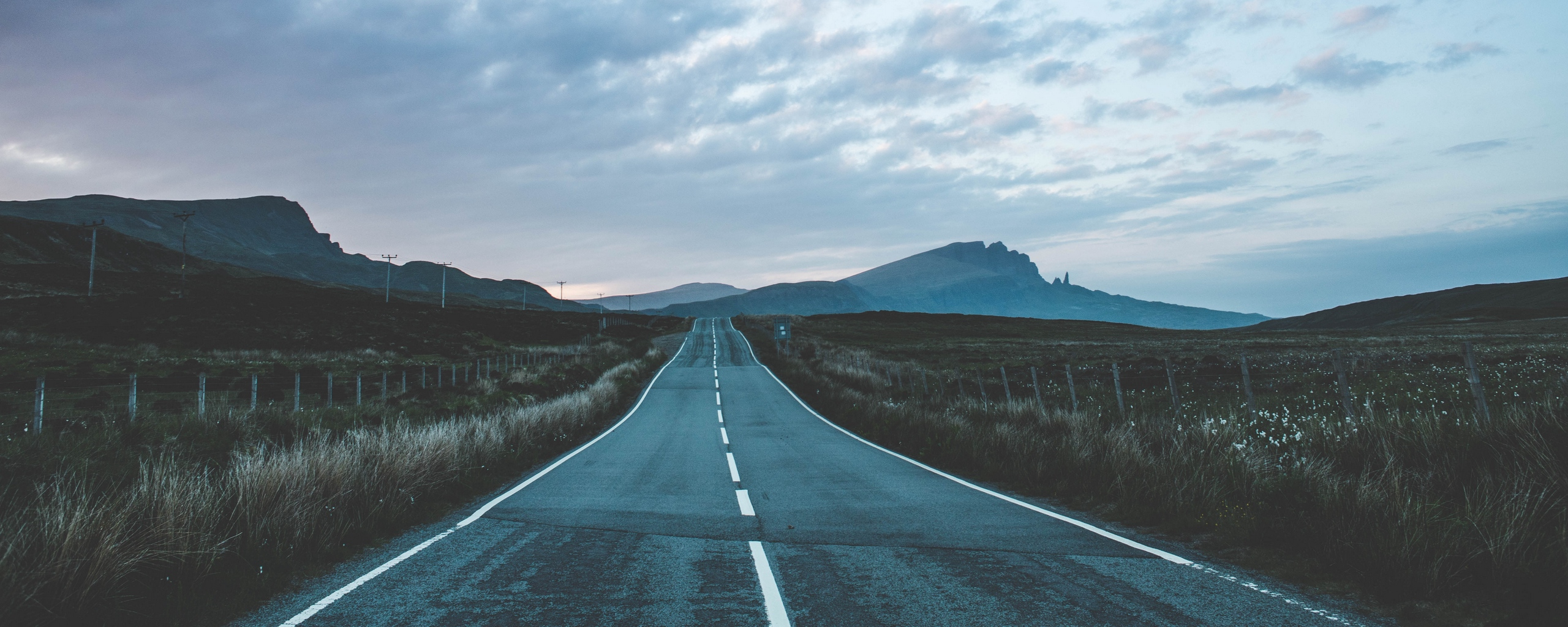 Download wallpaper 2560x1024 road marking mountains portree 2560x1024