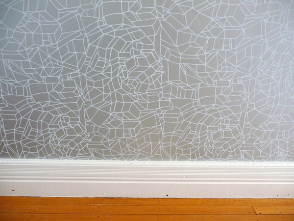 Wallpapering the hallway in progress Door Sixteen 600x450