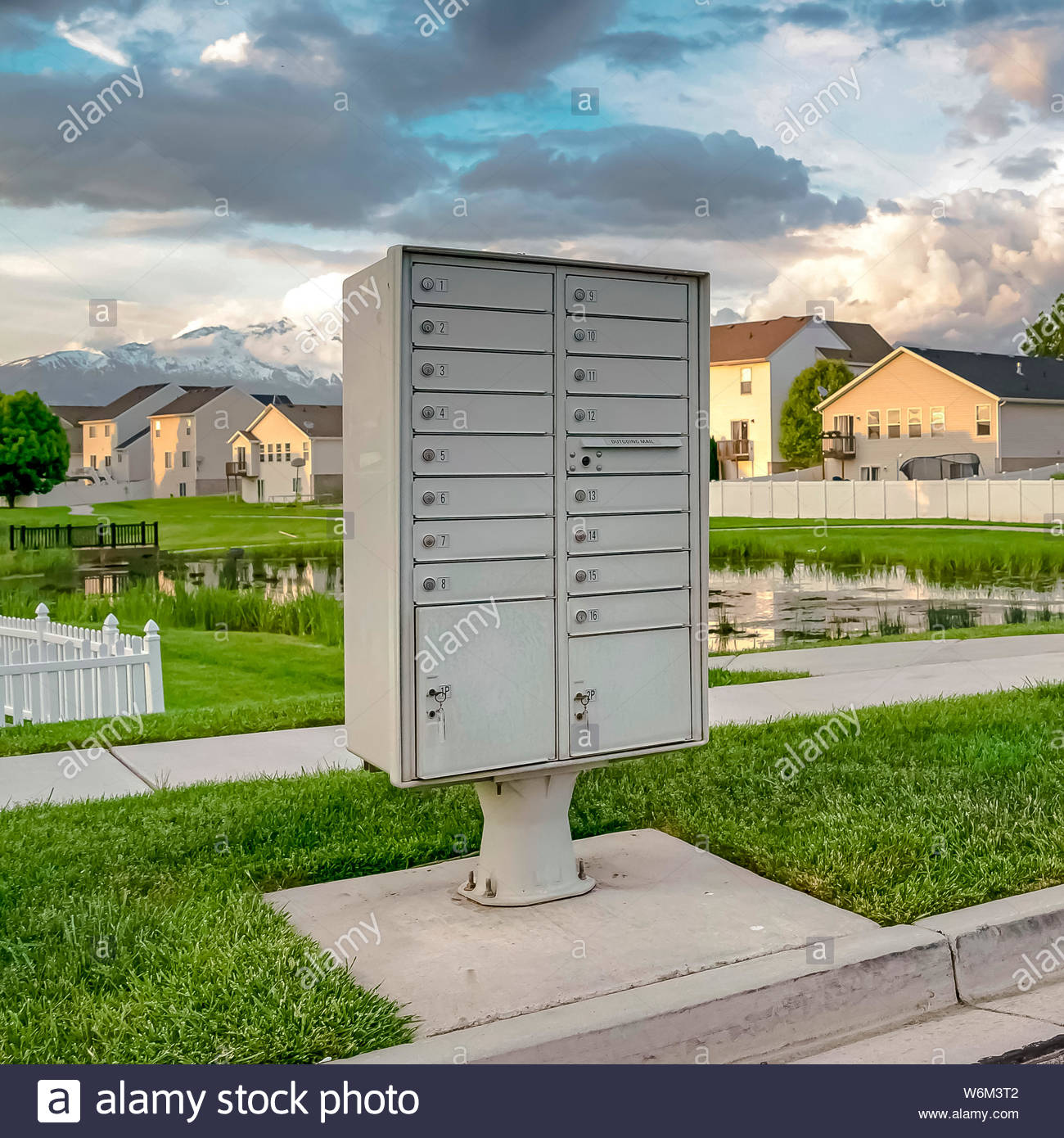 Square Mailbox on the side of the road with pond grassy terrain 1300x1390
