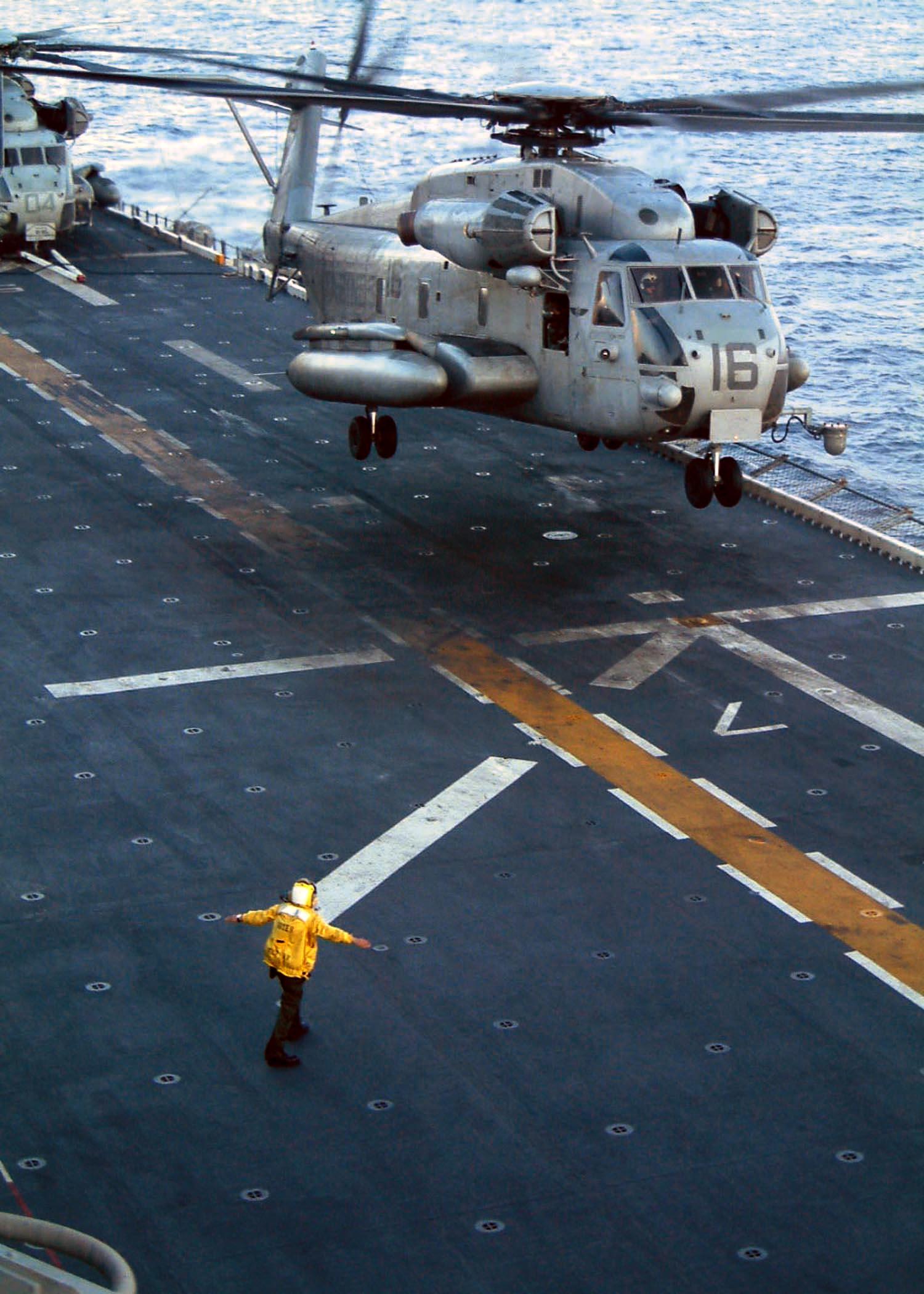 Description US Navy 030224 N 2321D 002 A flight deck director signals 1500x2100