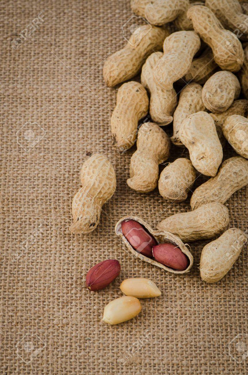 Peanuts On Old Raffia Background Stock Photo Picture And Royalty 861x1300