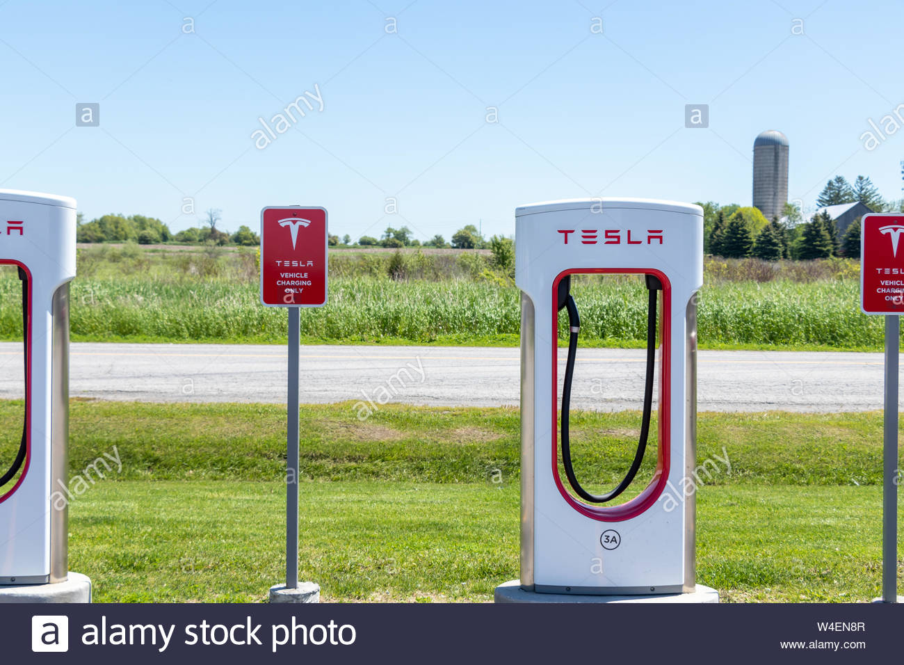 Tesla Supercharger and Tesla Electric Vehicle Only warning sign 1300x956