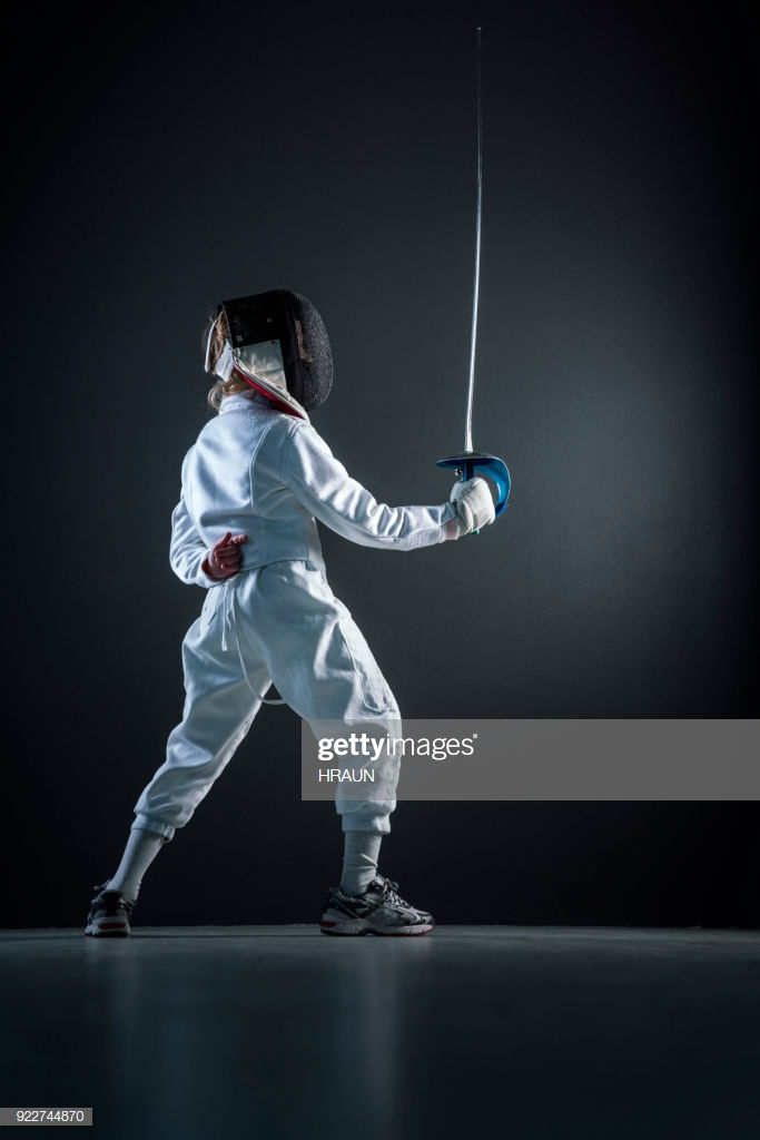 Boy Practicing Fencing Sport Over Black Background Stock Photo 683x1024