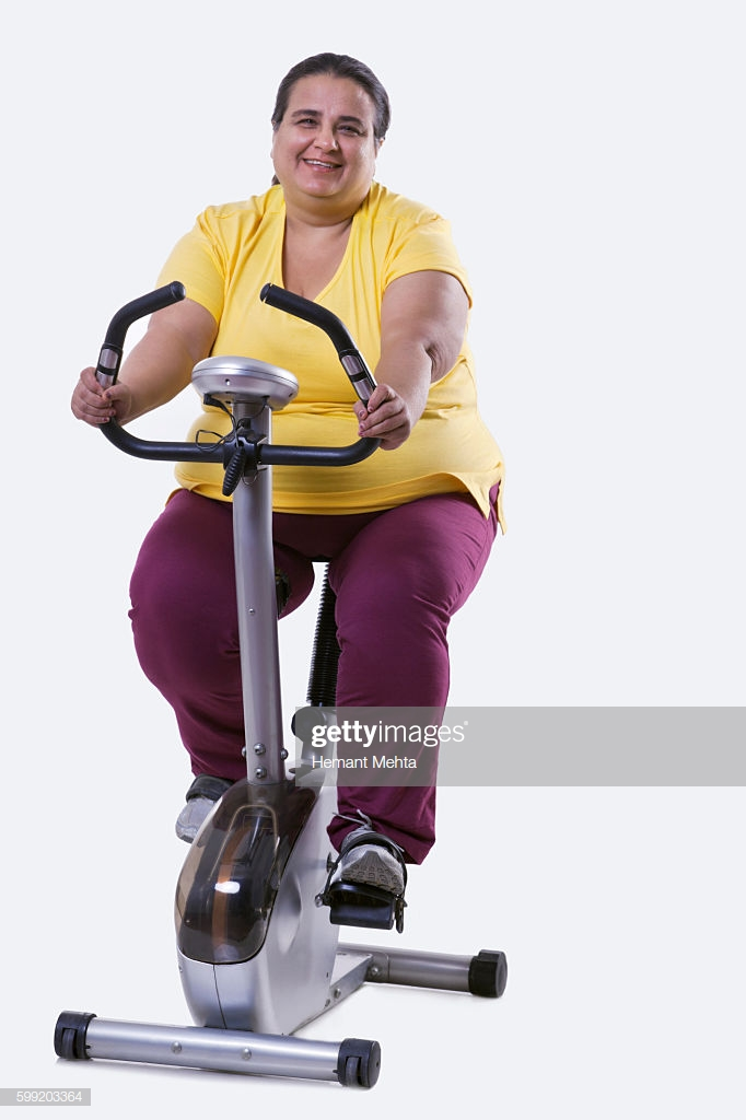 Portrait Of An Overweight Woman Exercising Over White Background 682x1024