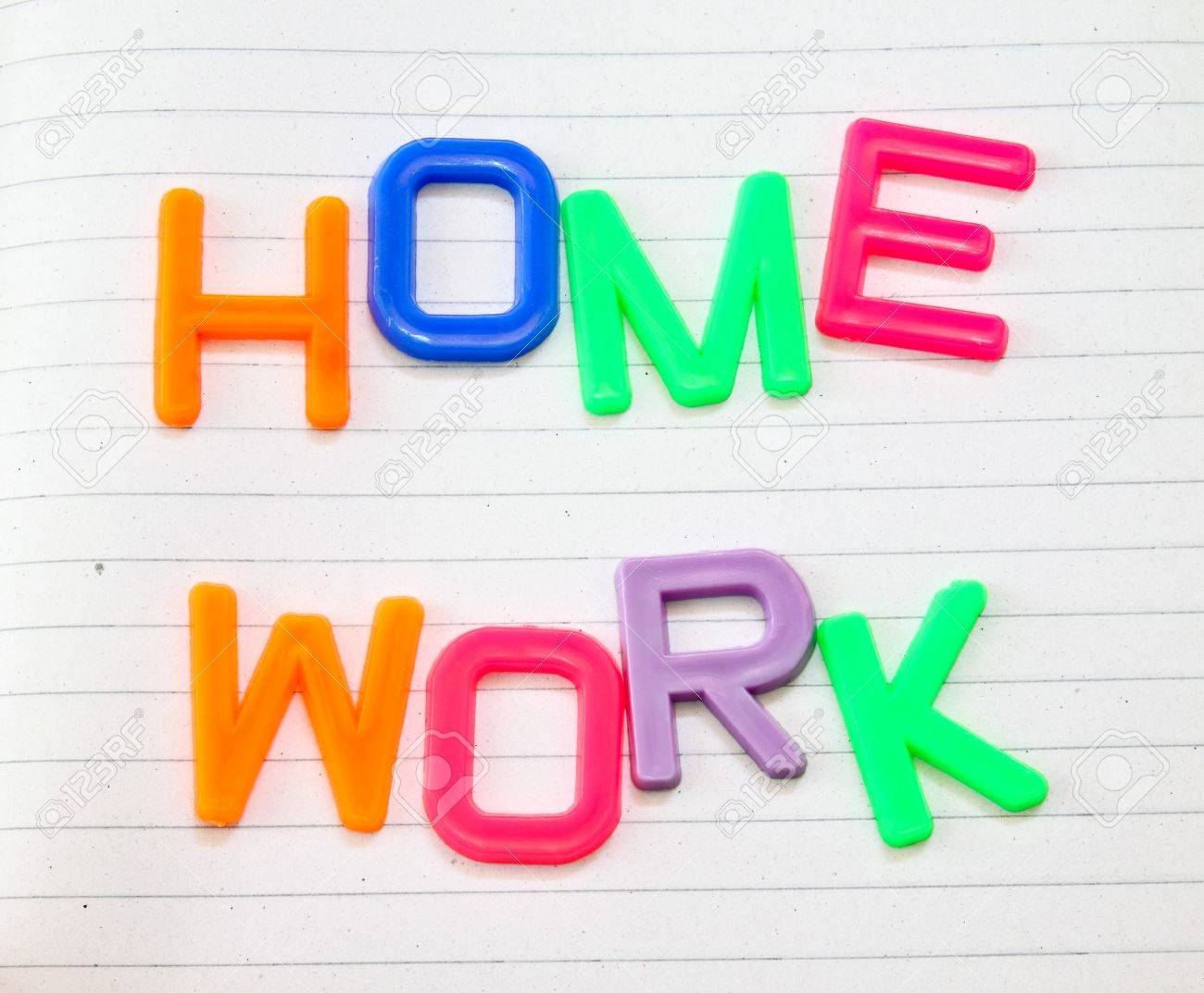 Homework In Colorful Toy Letters On Lined Paper Background Stock 1300x1073