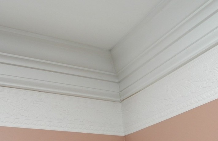 Crown Molding in the Living and Dining Rooms with wallpaper decorative 711x460