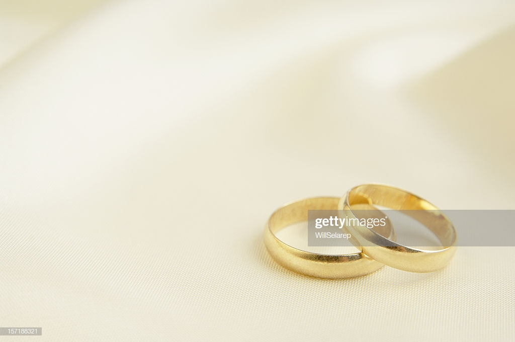 Two Rings On White Silk Background Stock Photo   Getty Images 1024x680