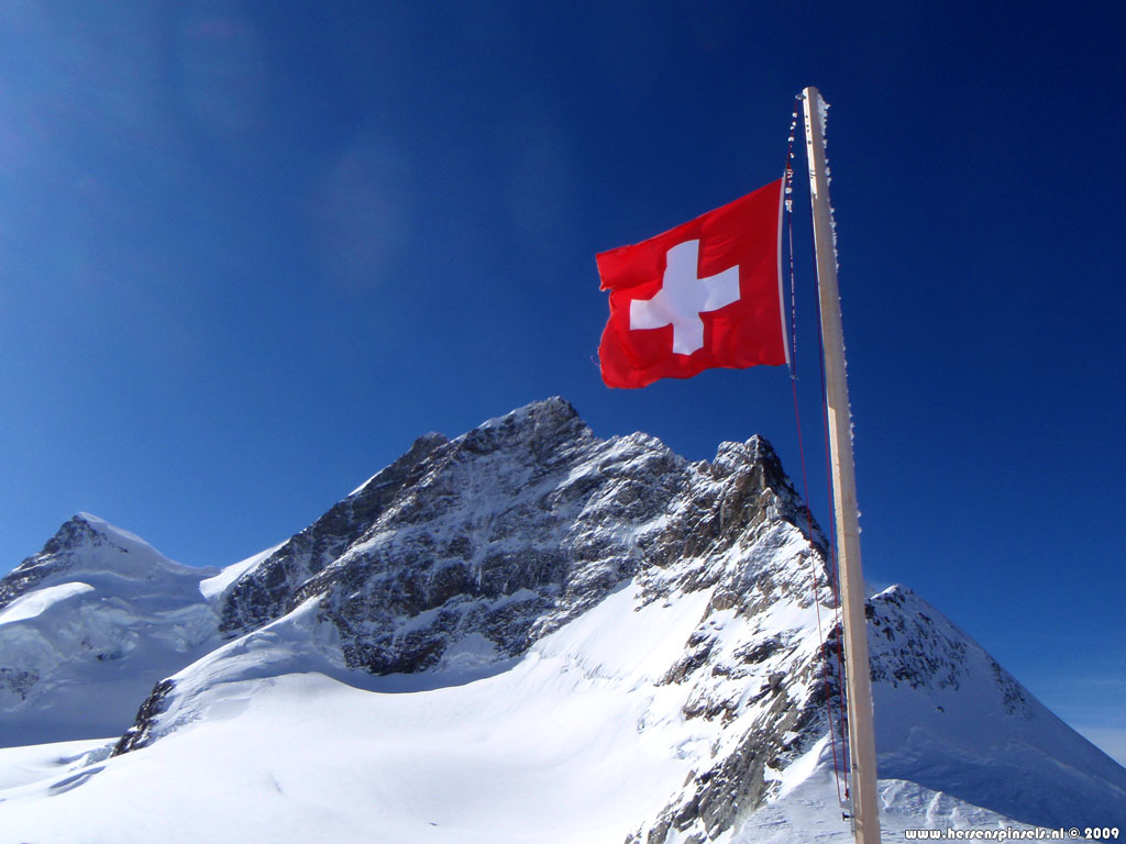 Wallpaper Jungfrau and flag   The Swiss flag is flying proudly 1024x768