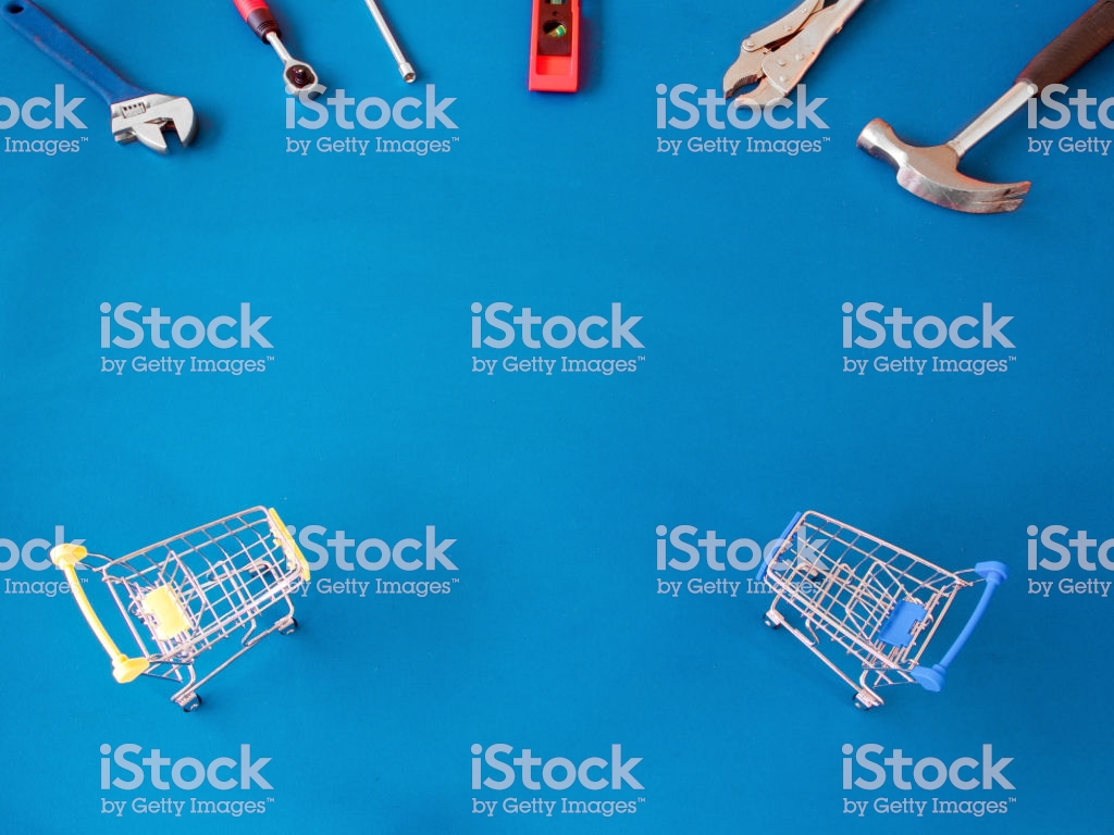 Craftsman Tools And Shopping Cart On Blue Wooden Background With 1024x768