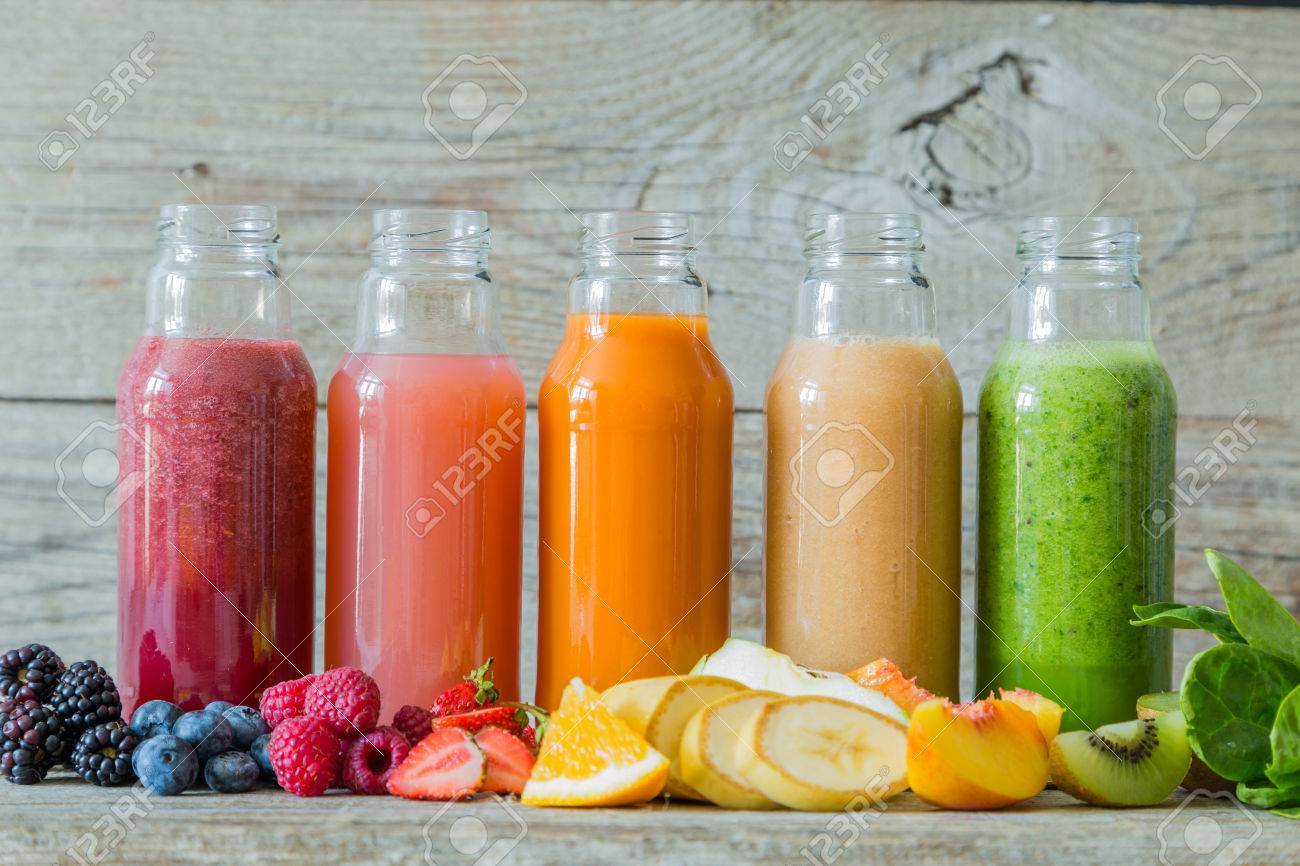 Selection Of Colourful Smoothies On Rustic Wood Background Copy 1300x866