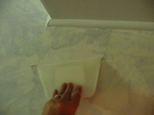 DIY Faux Finish Wall Covering Applying torn piece of wallpaper with 500x375