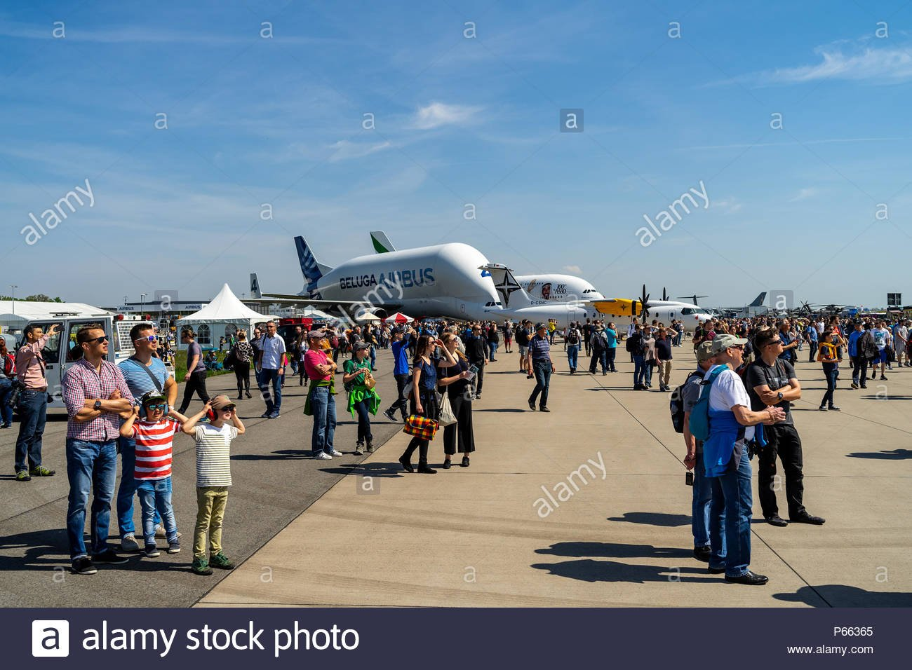 Visitors to the exhibition on the airfield In the background 1300x956