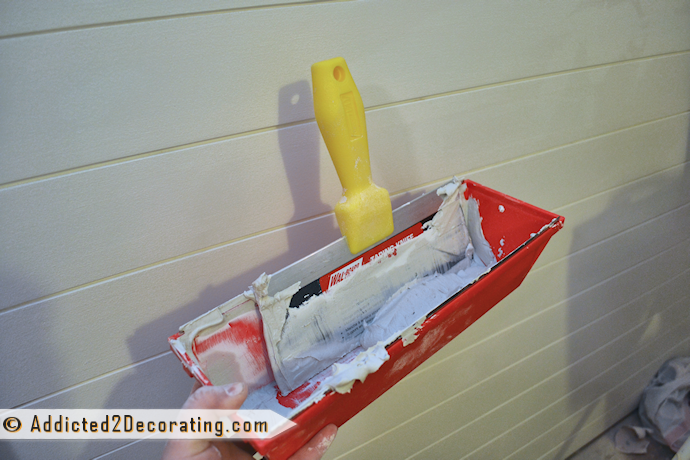 drywall mud and an 8  or 10 inch taping knife to mud over the seams 690x460