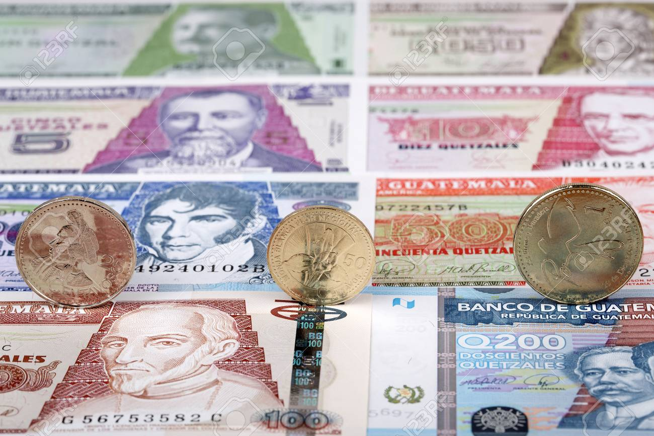 Guatemalan Quetzal Coins On A Background Of Banknotes Stock Photo 1300x866