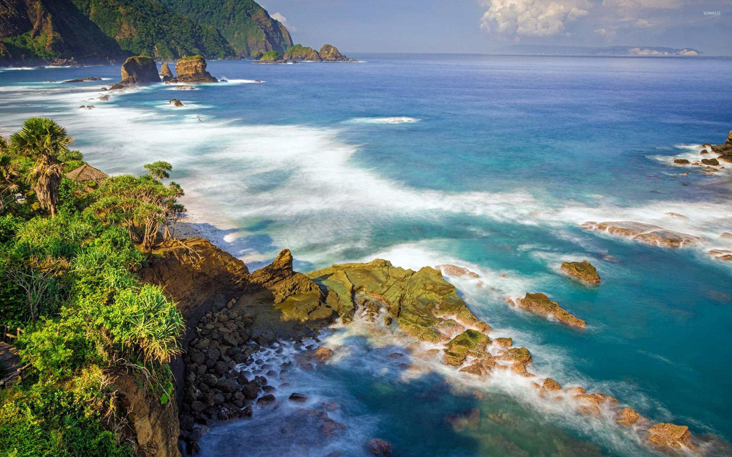 Rocks in the ocean near the exotic island wallpaper 2560x1600