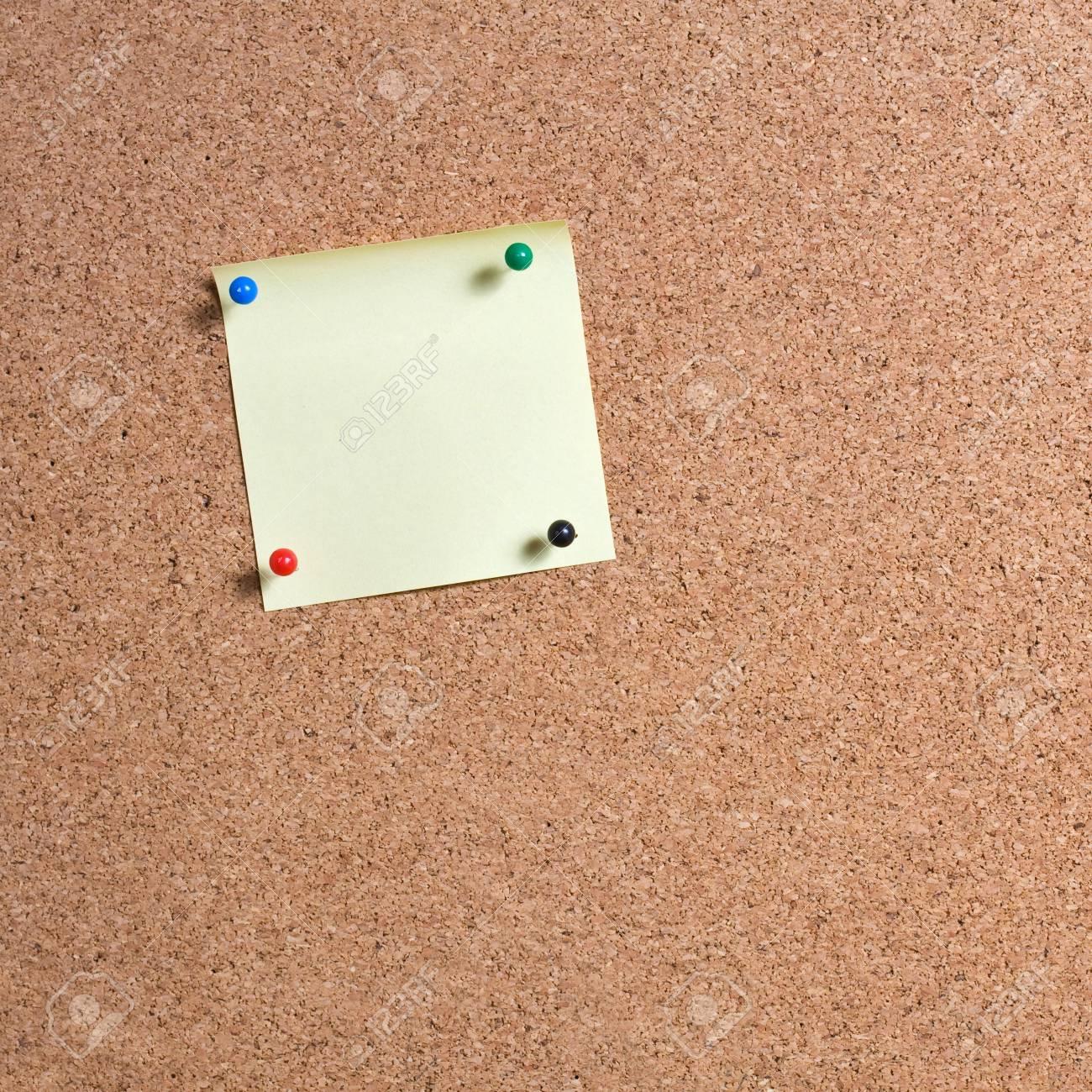 Yellow Memo Stick On Cork Board Background Stock Photo Picture 1300x1300