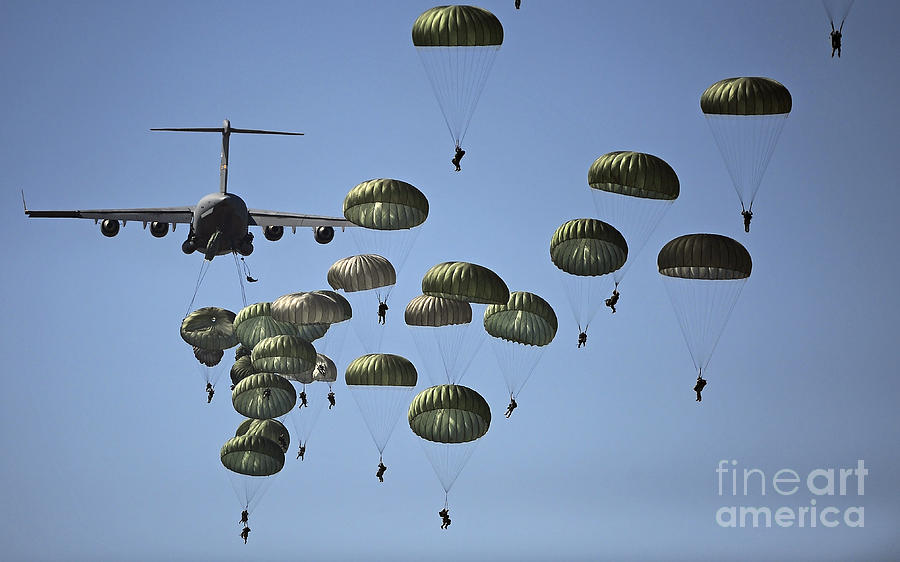 Army Paratroopers Jumping by Stocktrek Images 900x562