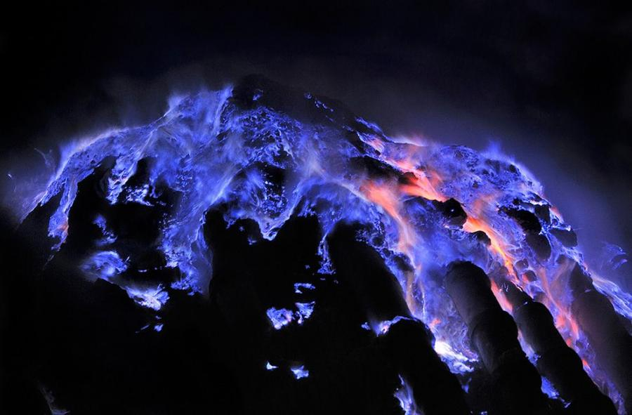 Flaming molten sulfur flows inside the volcanic crater Sulfur 900x591