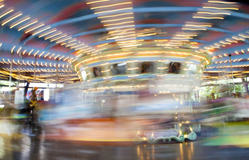 merry go round in motion blurred abstract form of a merry go round in ...