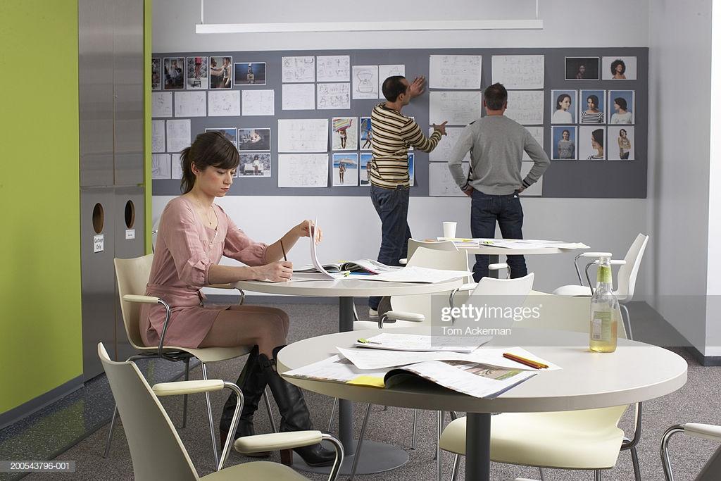 Businesswoman Working In Lunchroom Men Talking By Wall In 1024x683