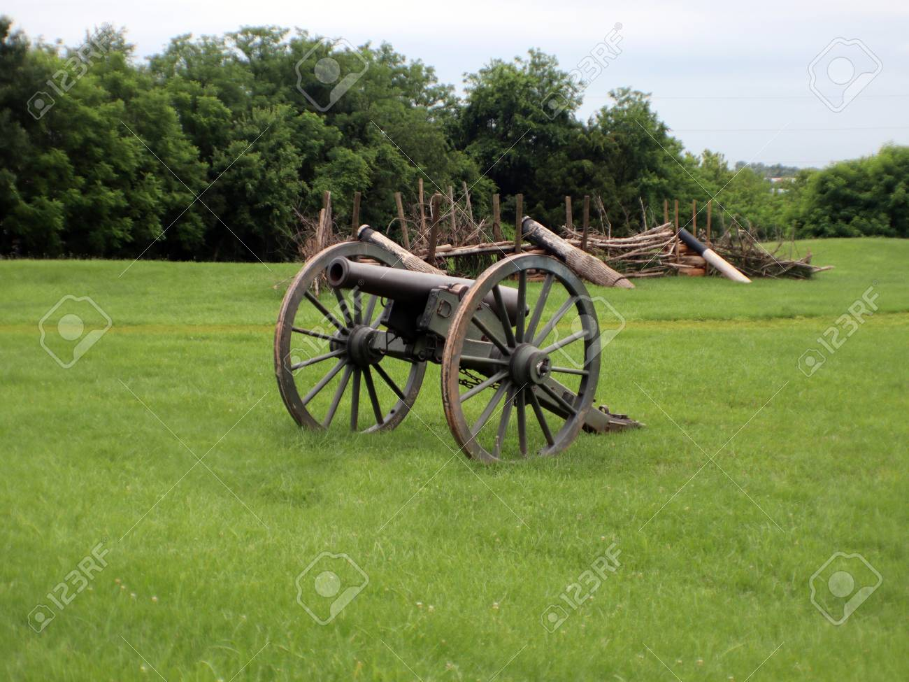 A Civil War Cannon With A Log Wall In The Background Stock Photo 1300x975