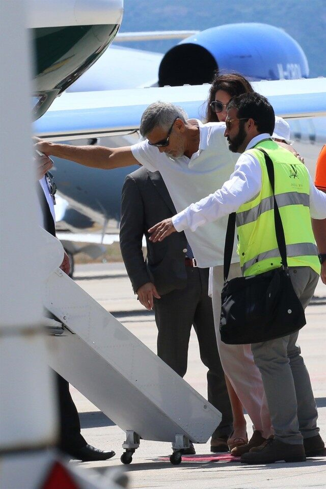 George Clooney Hobbles Onto Plane With Amal In First Sighting 640x960