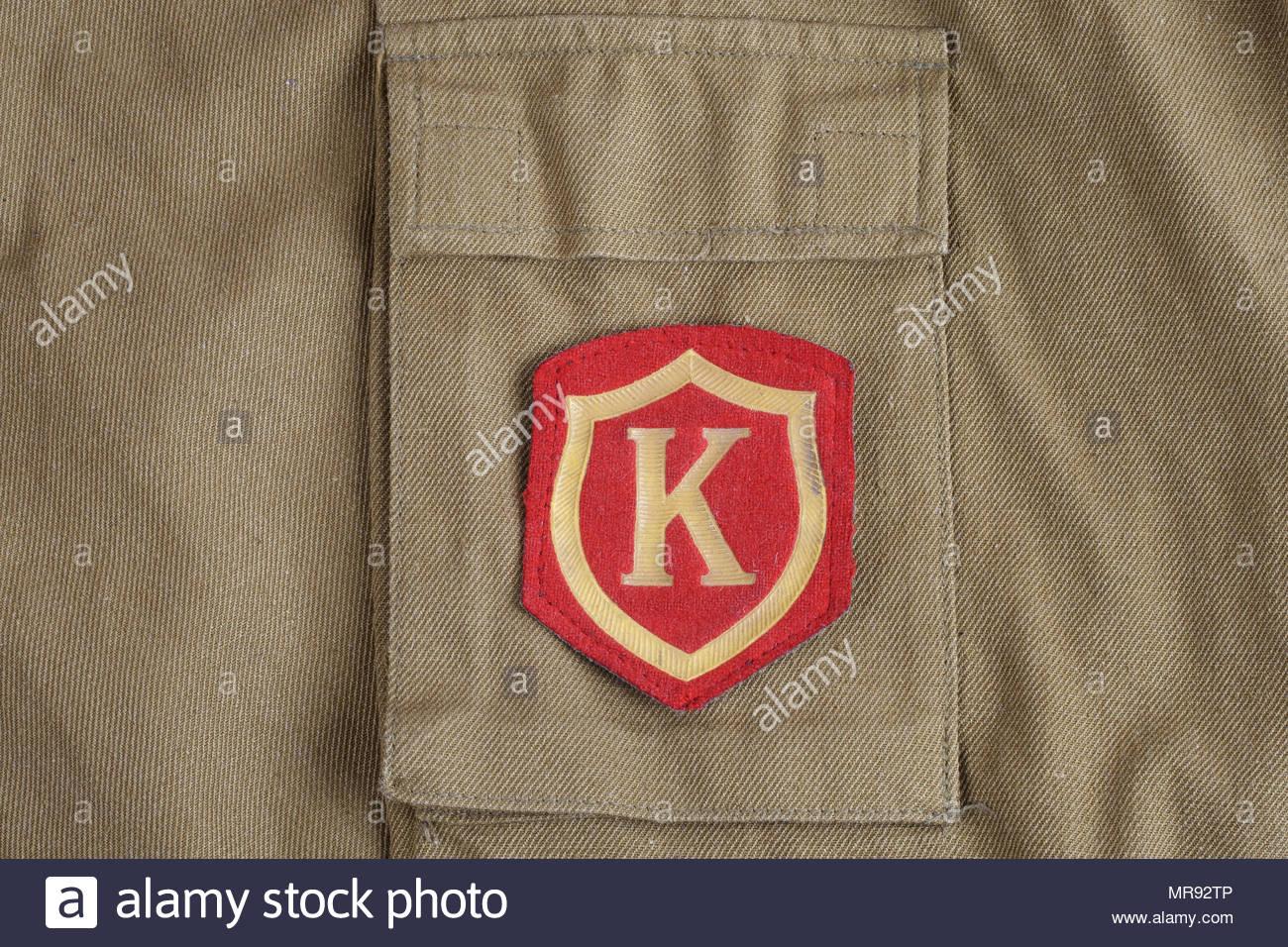 Soviet Army Commandant shoulder patch on khaki uniform background 1300x956