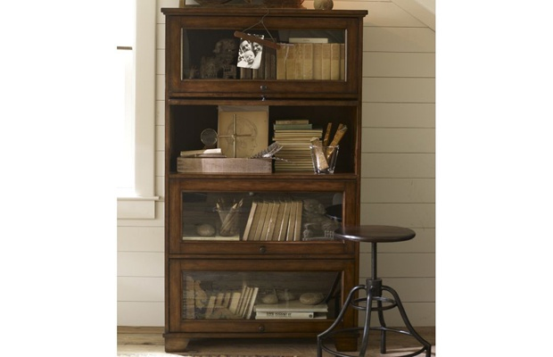 Wood and glass makes this Pottery Barn bookcase seem both warm and 620x400
