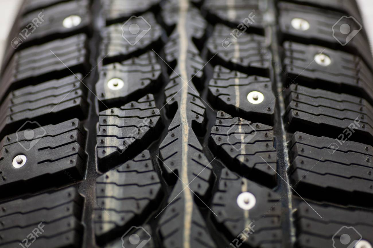 Studded Tire On A Background Winter Studded Tires For A Car New 1300x866