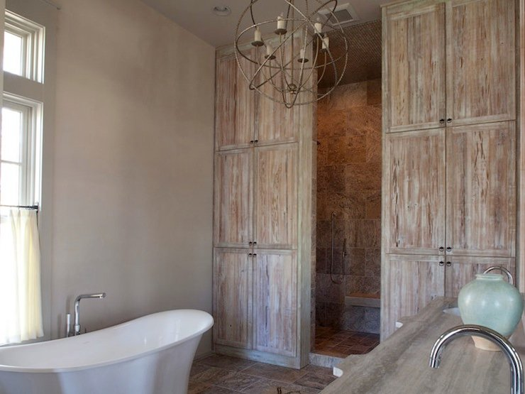 distressed style bathroom with floor to ceiling distressed wood 740x555