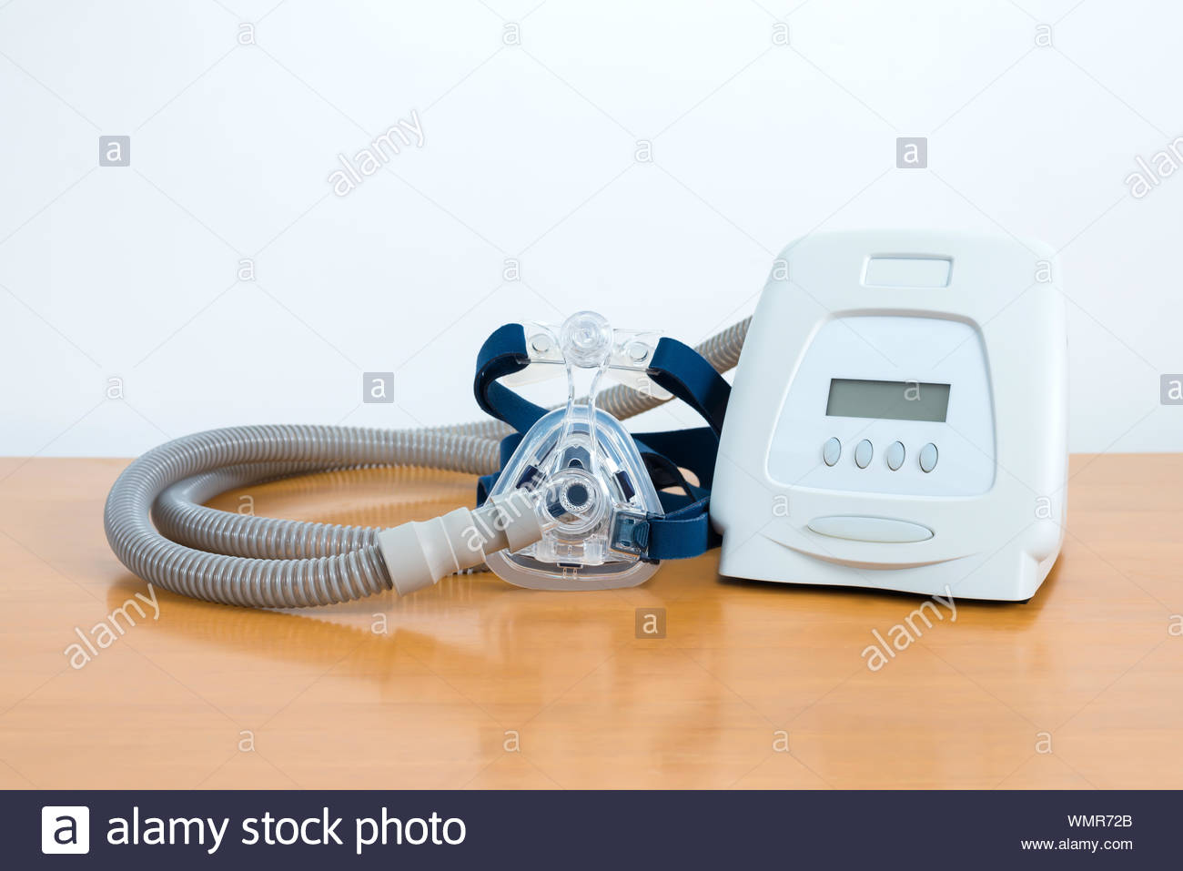 Full components of Cpap system on wooden table white background 1300x957