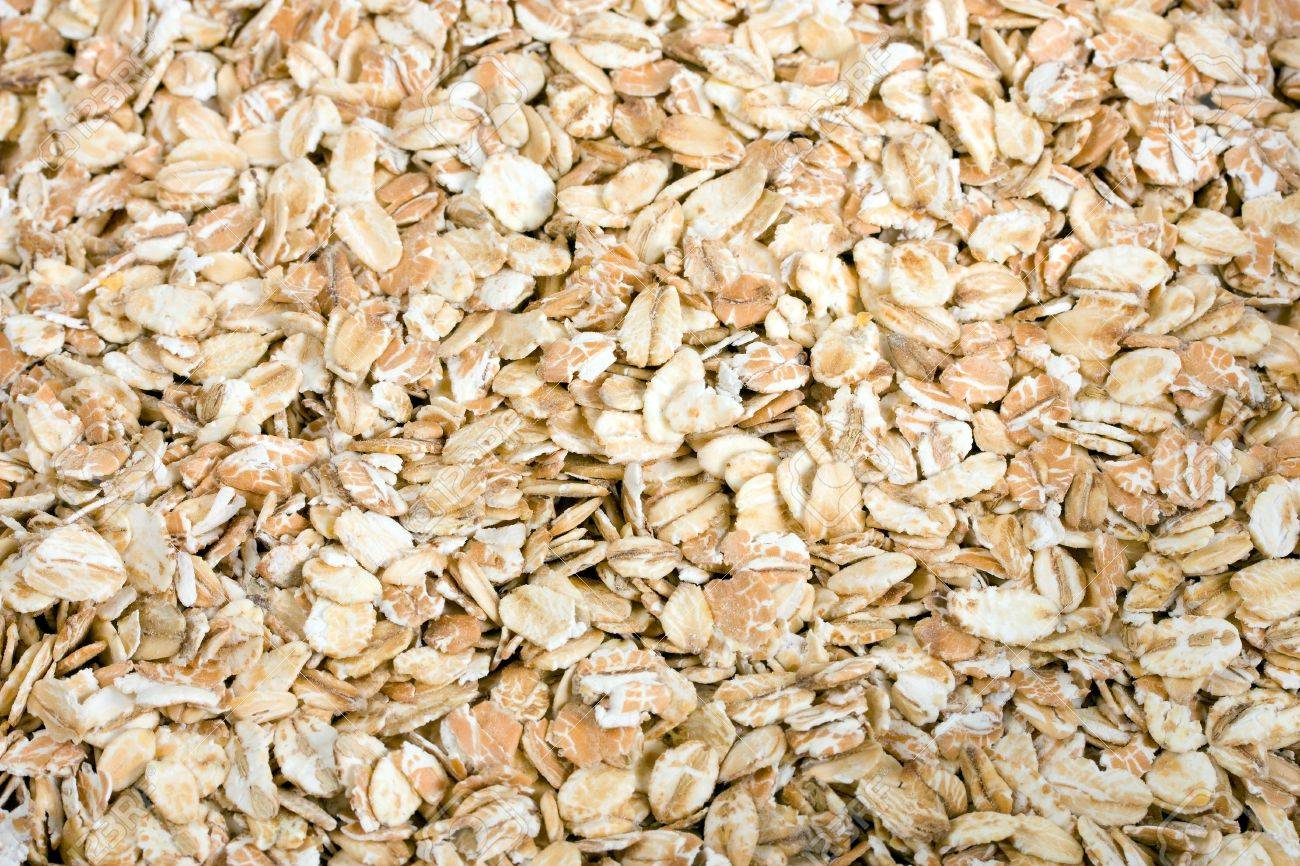 Pile Of Uncooked Rolled Oats   Oatmeal Background Stock Photo 1300x866