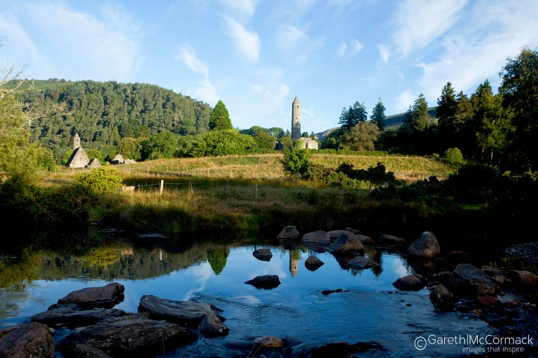 Reflection of Glendalough round tower Wicklow Mountains National 1050x700
