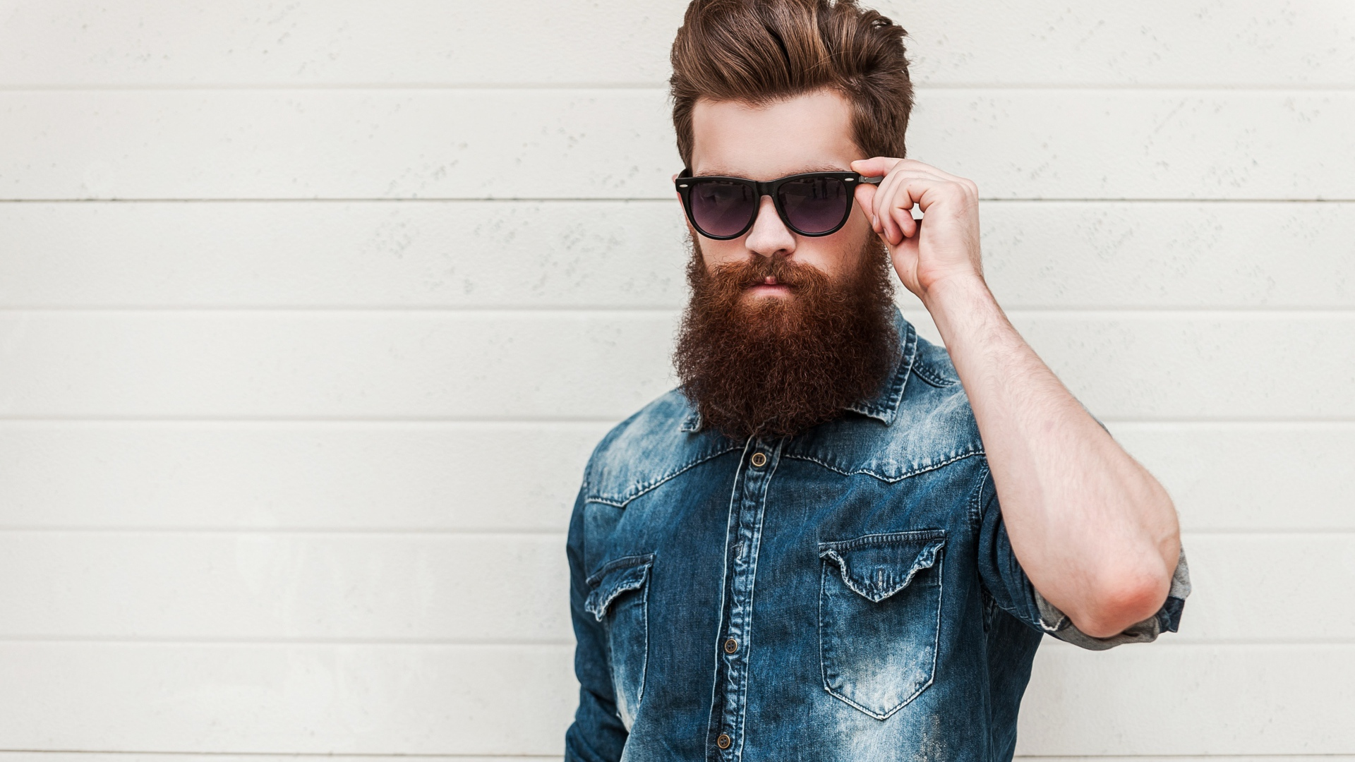 Handsome man with a beard in black glasses Desktop wallpapers 1920x1080