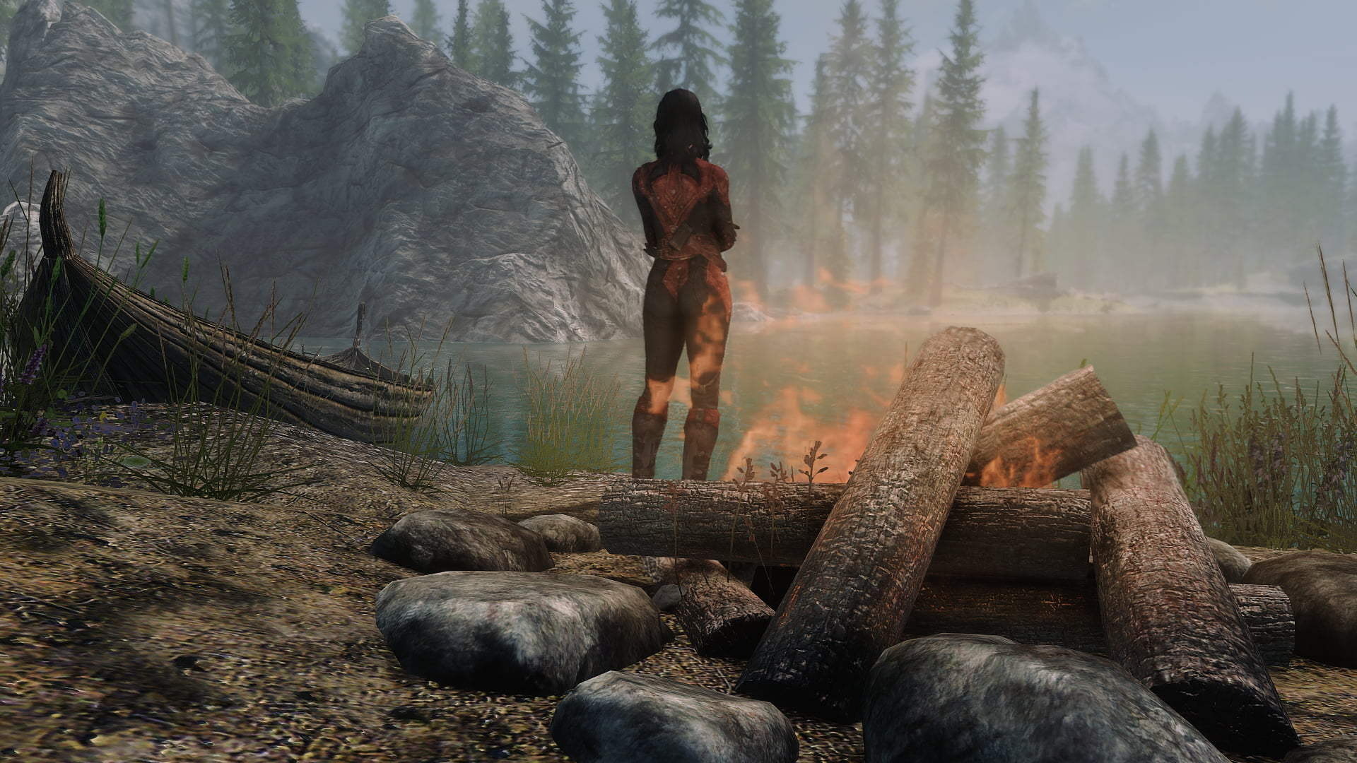 Flaming woman standing near body of water and burning woods HD 1920x1080
