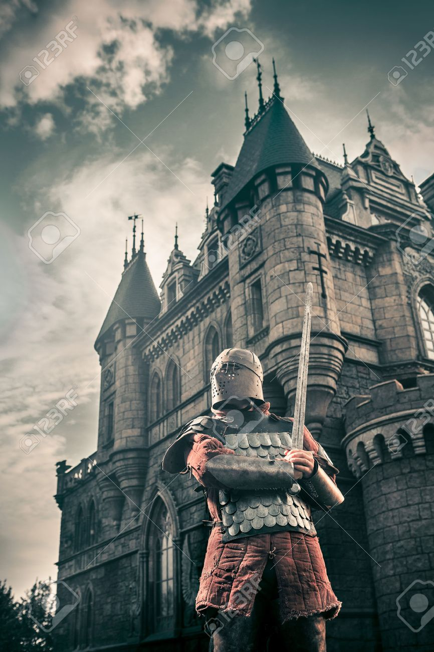 Medieval Knight With The Sword On The Ancient Castle Background 866x1300