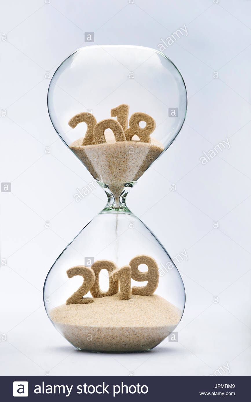 New Year 2019 concept with hourglass falling sand taking 867x1390