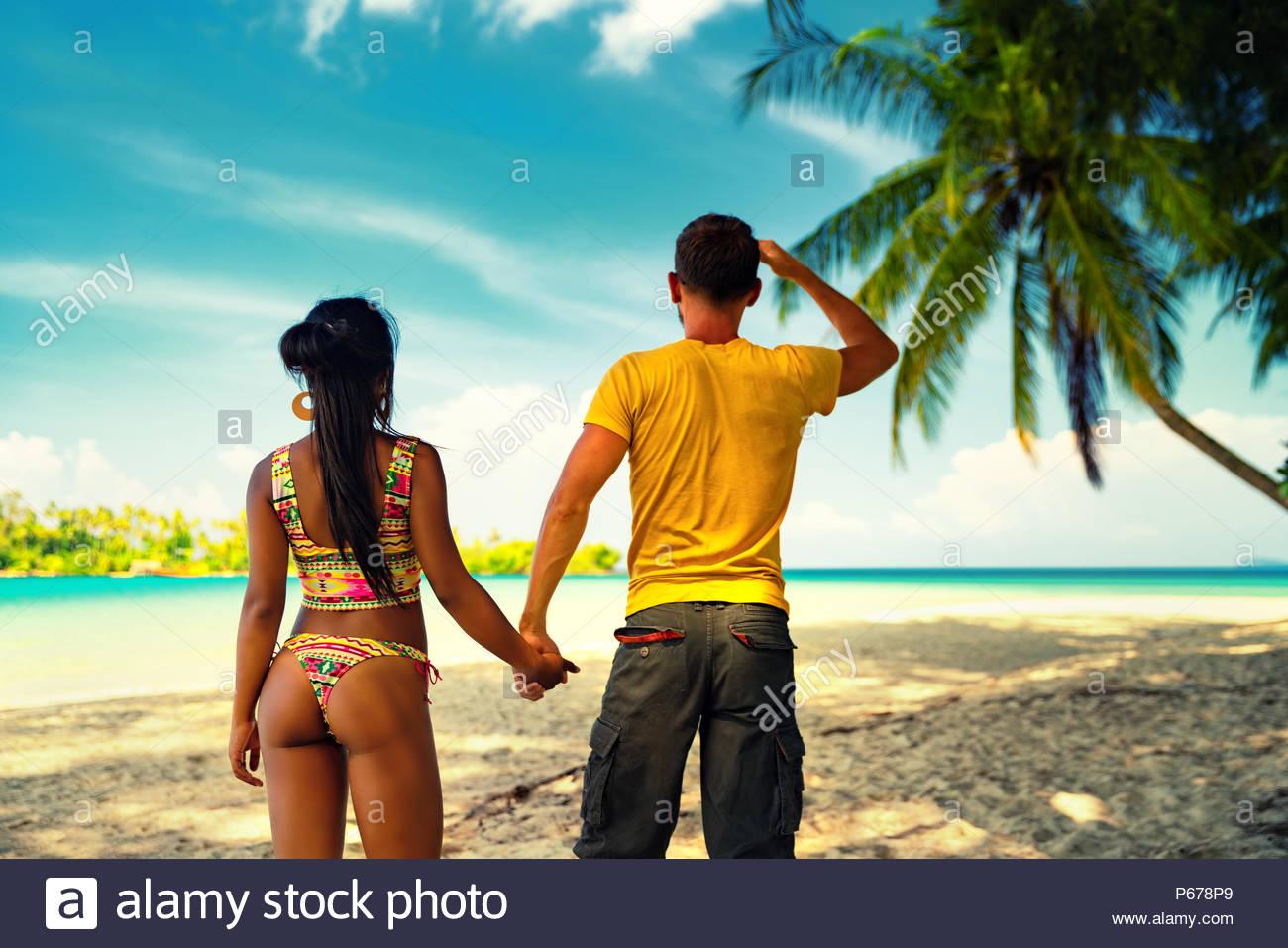 Interracial Loving couple people enjoy honeymoon in tropical 1300x957