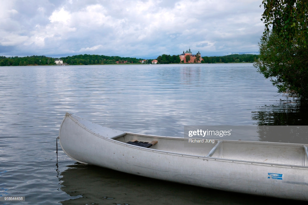 Canoe On Swedish Lake With Castle In Background Stock Photo 1024x684