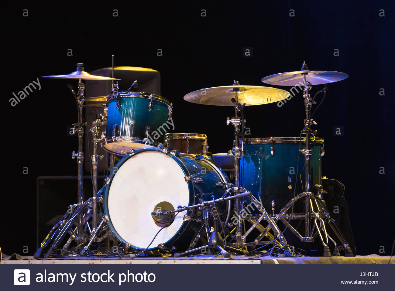 Drum Set On A Stage At Dark Background Musical Drums Kit On Stage 1300x956