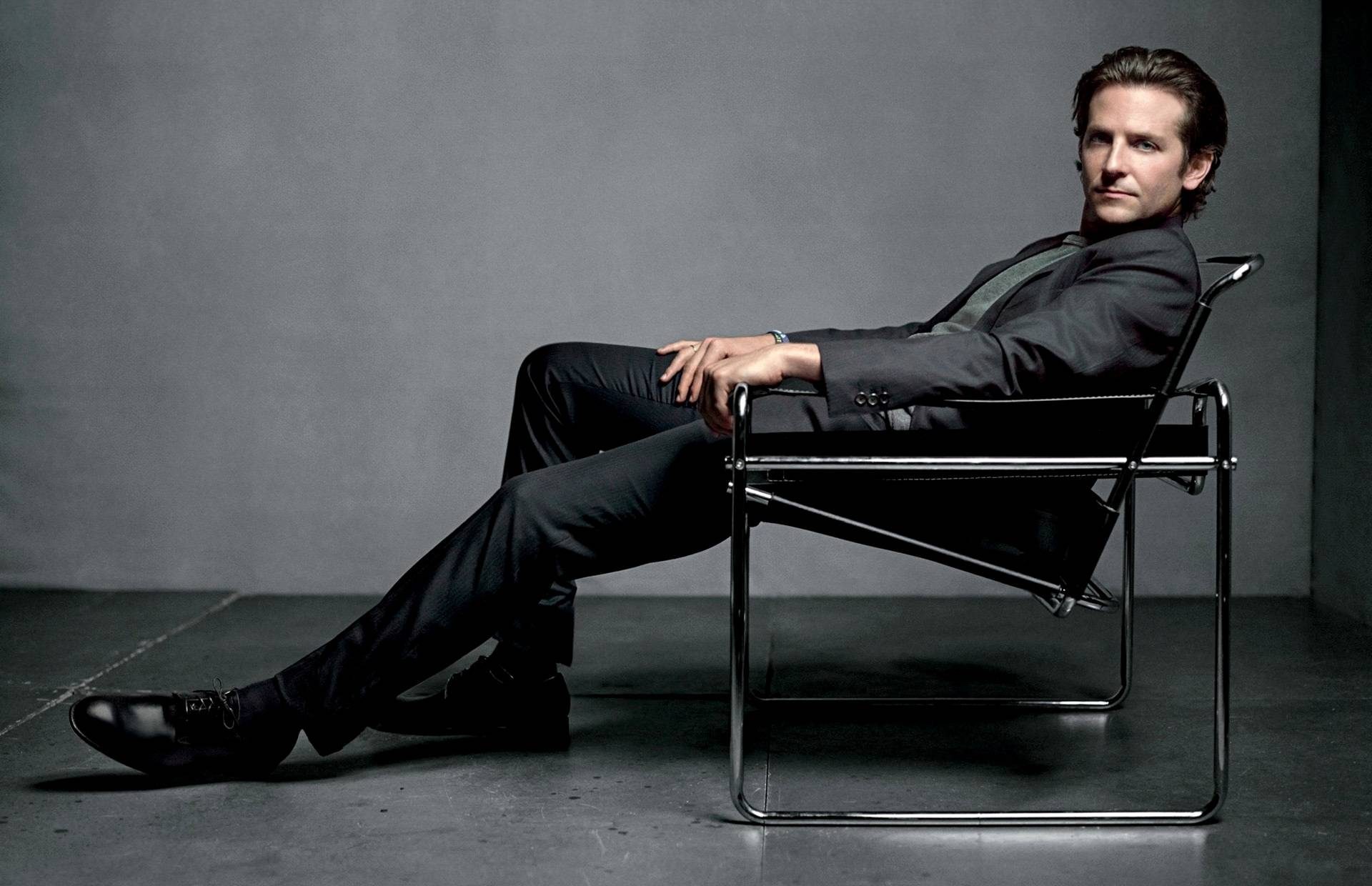 bradley cooper Wallpaper tags actor man suit chair 1505259306 1920x1240